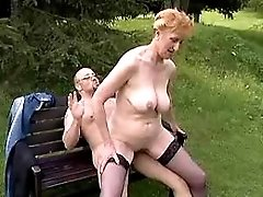 Redhead granny fucked by man in park