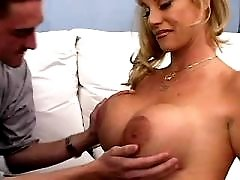 Mom with awesome tits gets sex on sofa