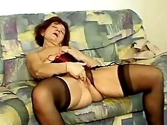 Mature in high boots gets facial