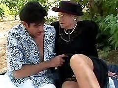 Hungry grandma sucks cock outdoor
