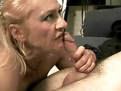 Milf sucks big black dick and fucks